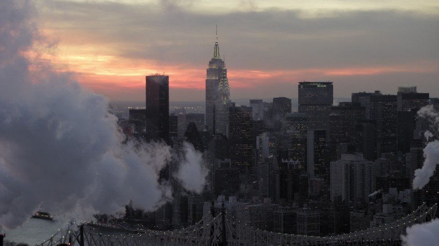 5K stock footage aerial video of Midtown smoke stacks and skyscrapers in winter, New York City, twilight Aerial Stock Footage AX66_0319