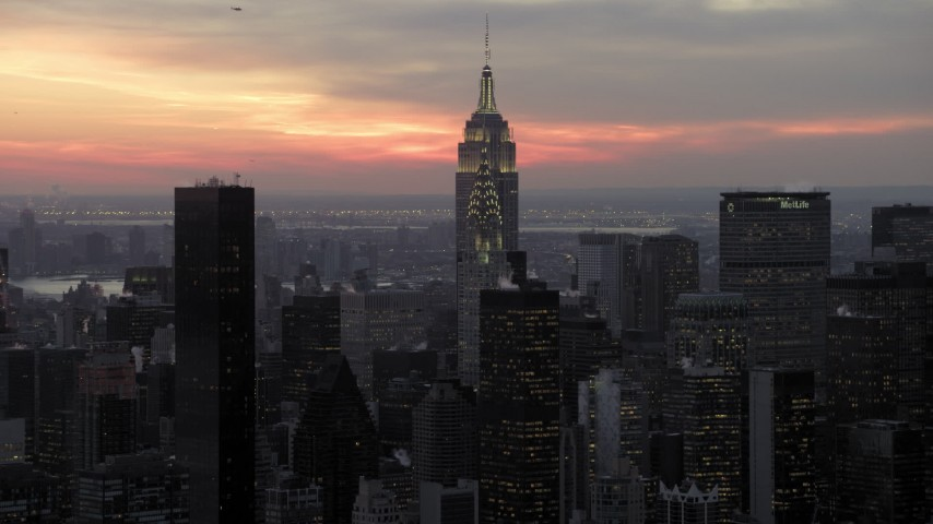 Chrysler and Empire State Building in winter, New York City twilight Aerial Stock Footage | AX66_0322