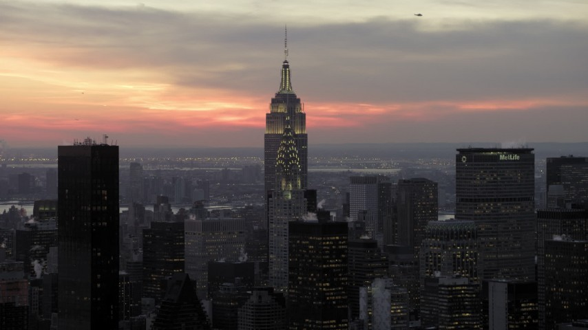 5K stock footage aerial video fly toward Chrysler and Empire State Building in winter, New York City, twilight Aerial Stock Footage | AX66_0322