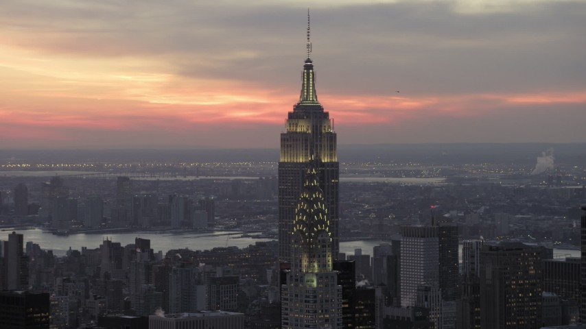 5K aerial video of approaching Chrysler Building and Empire State Building in winter, New York City, twilight Aerial Stock Footage | AX66_0324