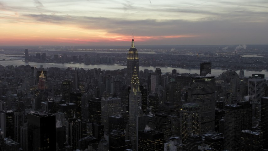 Chrysler Building and Empire State Building in winter, New York City twilight Aerial Stock Footage | AX66_0325
