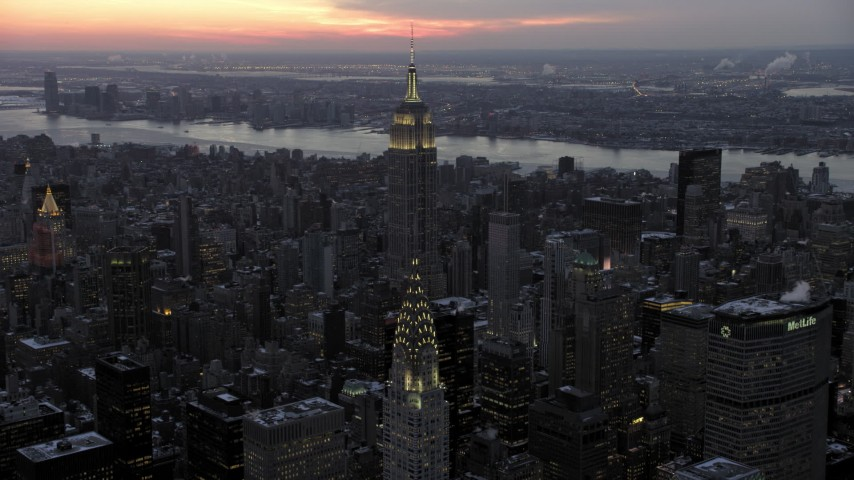 5K stock footage aerial video Empire State Building seen from Chrysler Building in winter, New York City, twilight Aerial Stock Footage | AX66_0326