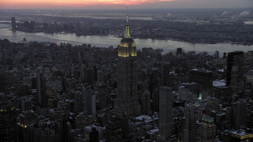5K stock footage aerial video of Empire State Building in winter, New York City, twilight Aerial Stock Footage   AX66_0327