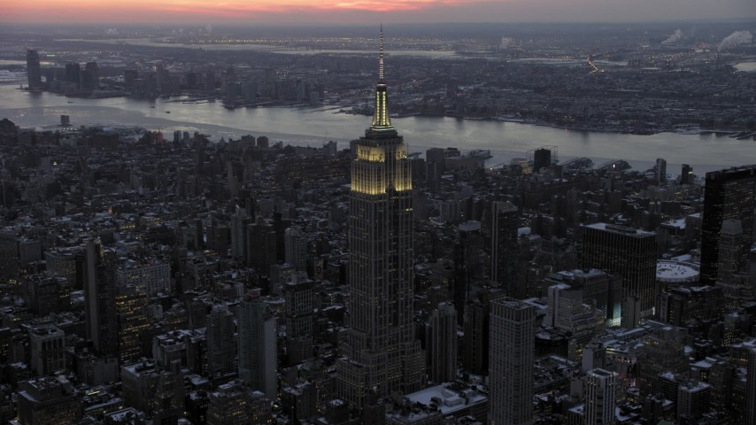5K stock footage aerial video an approach to the Empire State Building in winter, New York City, twilight Aerial Stock Footage | AX66_0328