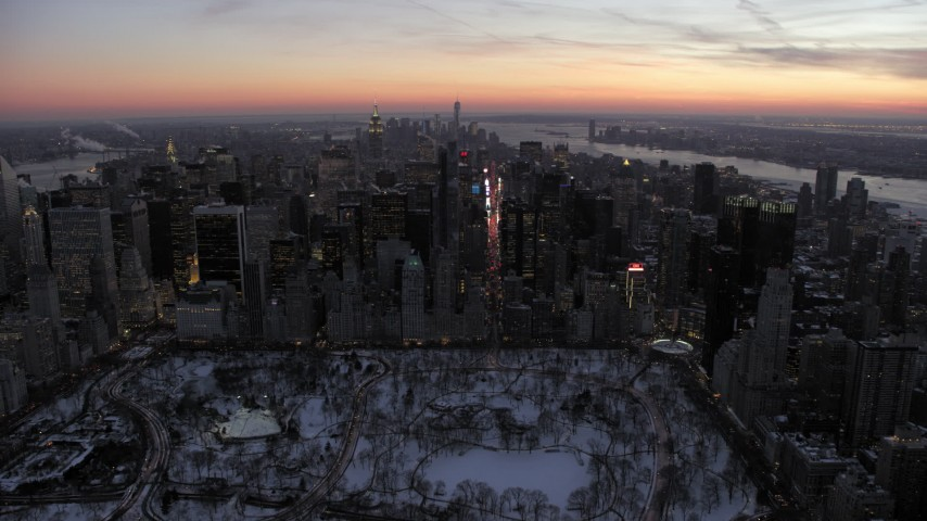 5K stock footage aerial video approach Times Square and Midtown Manhattan in winter, New York City, twilight Aerial Stock Footage | AX66_0334