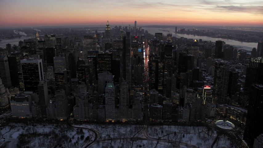 5K stock footage aerial video approaching Times Square and Midtown Manhattan in winter, New York City, twilight Aerial Stock Footage | AX66_0335
