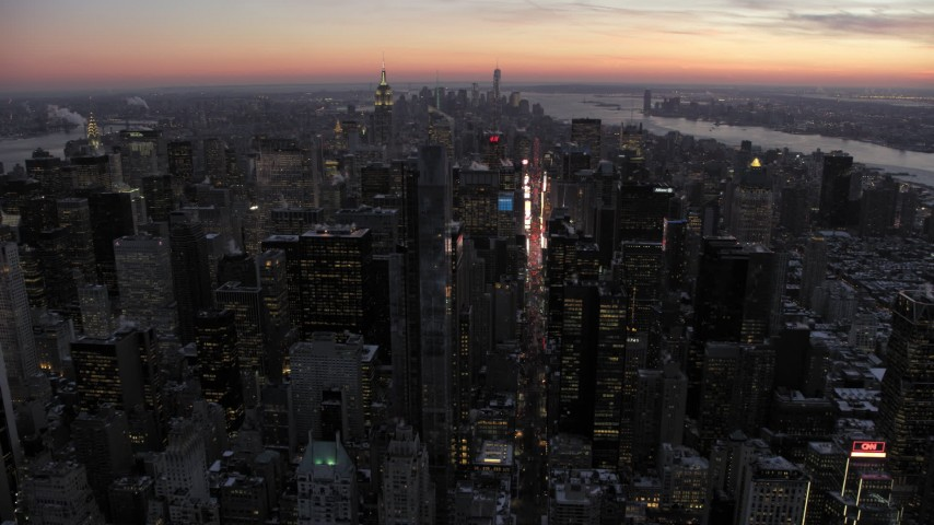 5K stock footage aerial video an approach to Times Square and Midtown in winter, New York City, twilight Aerial Stock Footage | AX66_0336