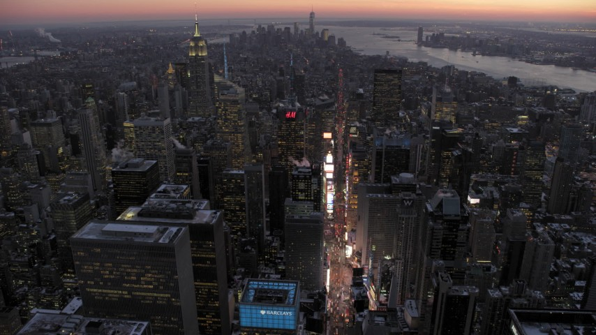 5K stock footage aerial video tilt to Times Square and Midtown in winter, New York City, twilight Aerial Stock Footage AX66_0338 | Axiom Images