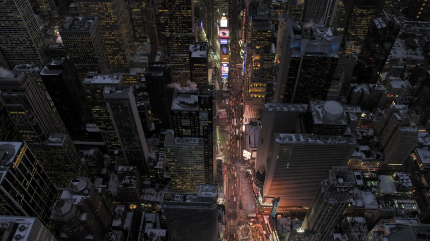 5K aerial video tilt to a bird's eye view of Times Square in winter, New York City, twilight Aerial Stock Footage | AX66_0339