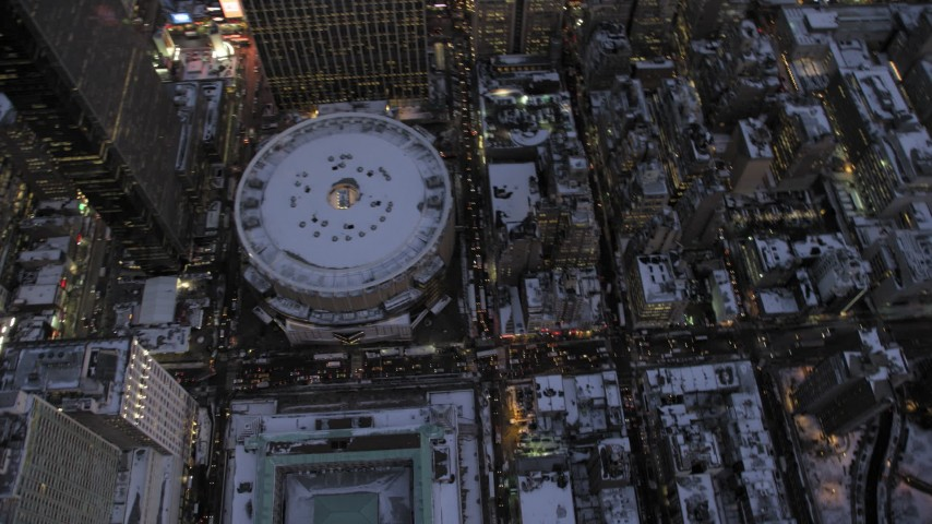 Madison Square Garden in winter, New York City twilight Aerial Stock Footage | AX66_0342