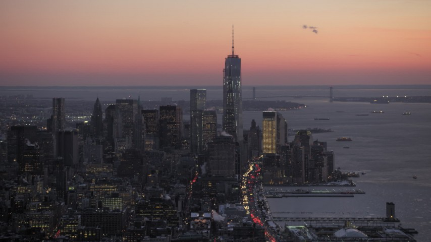 One World Trade Center and Lower Manhattan skyscrapers in winter, New York City twilight Aerial Stock Footage | AX66_0343
