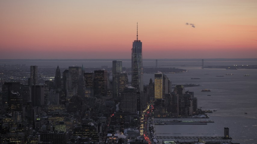 5K stock footage aerial video of a wide view of Freedom Tower and downtown skyscrapers in winter, New York City, twilight Aerial Stock Footage | AX66_0343