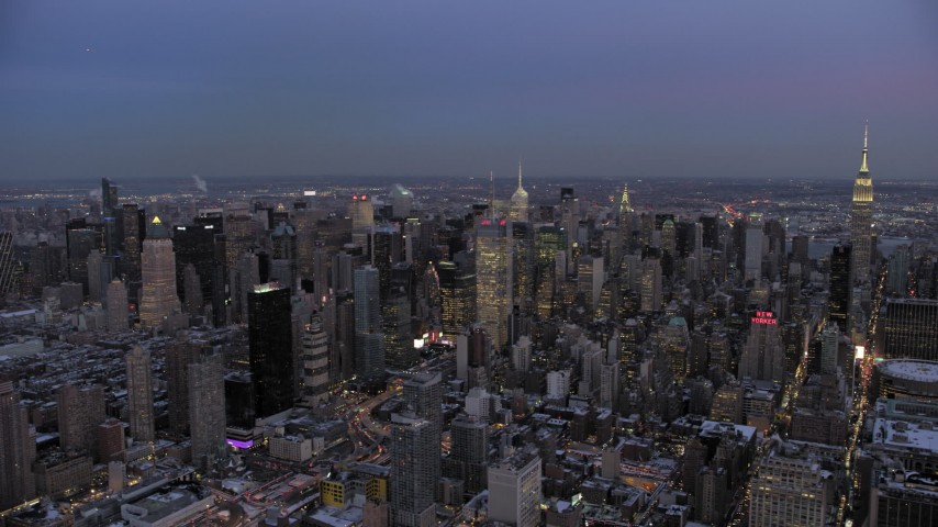5K stock footage aerial video of Midtown Manhattan skyscrapers in winter, New York City, twilight Aerial Stock Footage | AX66_0344