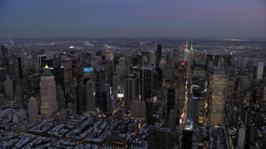 5K stock footage aerial video pan across Midtown Manhattan skyscrapers in winter, New York City, twilight Aerial Stock Footage | AX66_0346