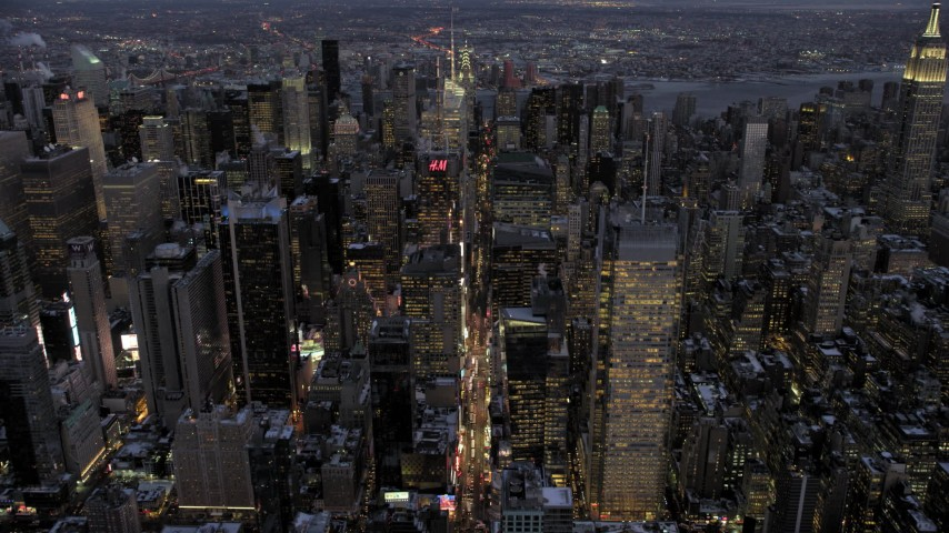 5K stock footage aerial video of Midtown Manhattan skyscrapers in winter, New York City, twilight Aerial Stock Footage | AX66_0347
