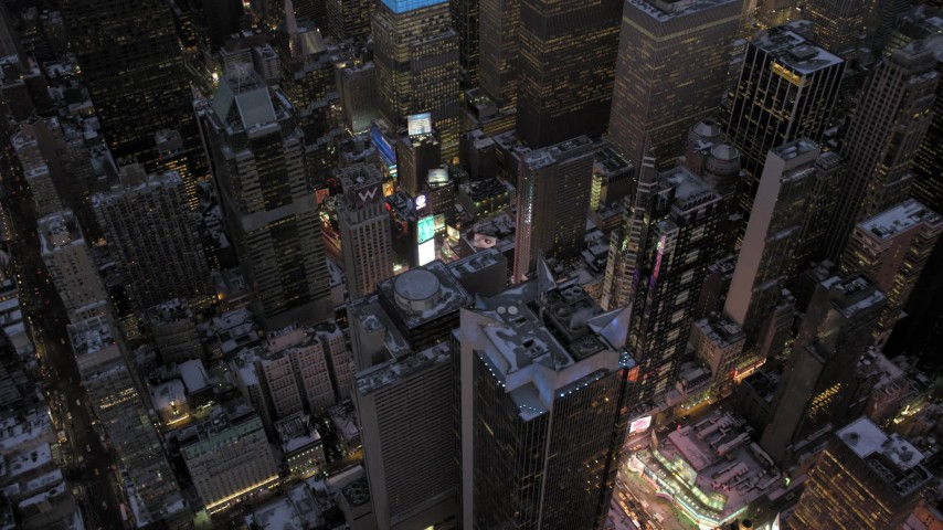 5K stock footage aerial video orbit Times Square in winter, New York City, twilight Aerial Stock Footage | AX66_0348