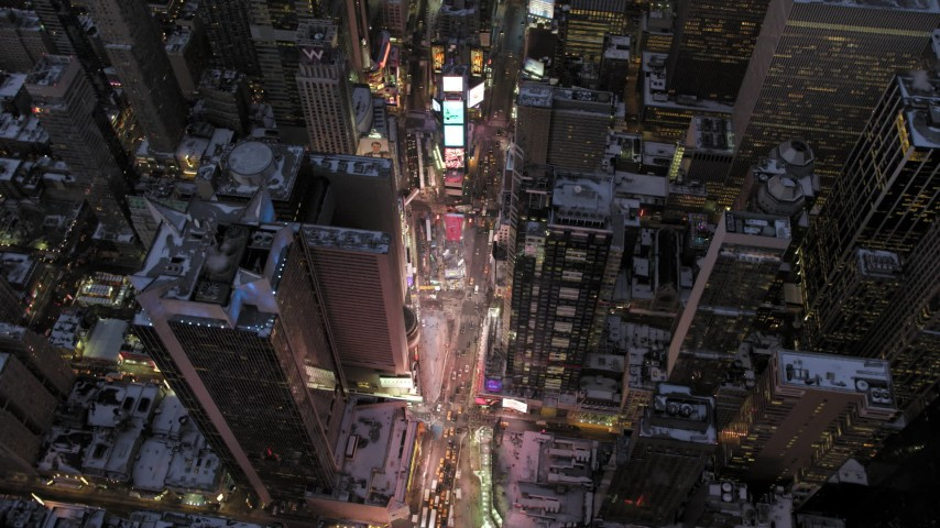5K stock footage aerial video of an orbit of Times Square in winter, New York City, twilight Aerial Stock Footage | AX66_0349