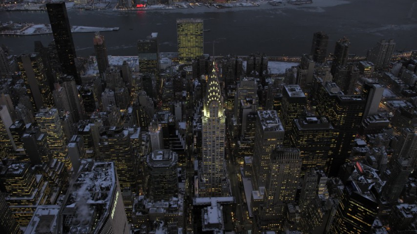 5K stock footage aerial video approach the Chrysler Building in snow, New York City, twilight Aerial Stock Footage | AX66_0350