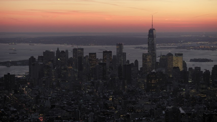 Lower Manhattan skyscrapers in winter, New York City twilight Aerial Stock Footage | AX66_0352