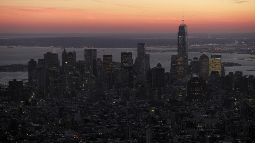 5K stock footage aerial video of Lower Manhattan skyscrapers in wintertime, New York City, twilight Aerial Stock Footage | AX66_0353