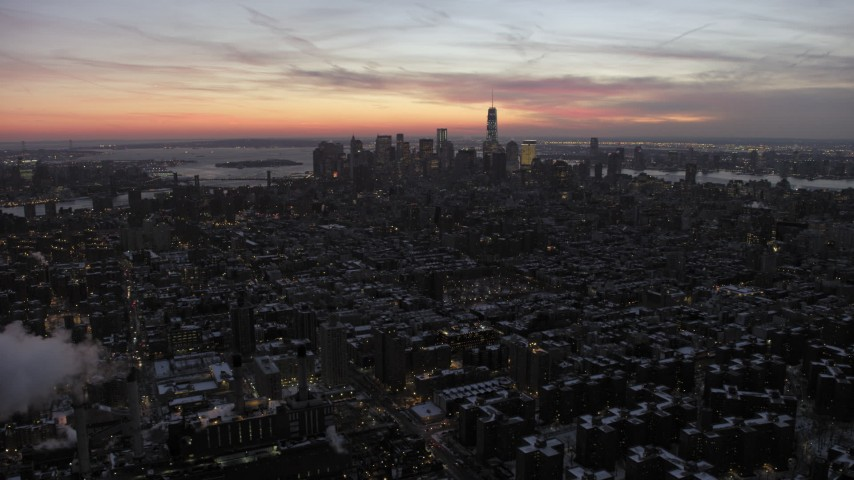 5K stock footage aerial video of distant Lower Manhattan skyscrapers in winter, New York City, twilight Aerial Stock Footage | AX66_0355