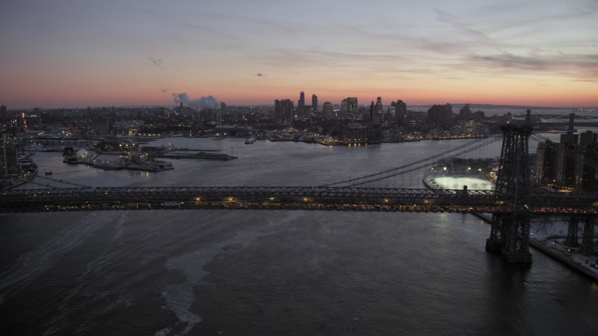 Williamsburg Bridge and Lower East Side in winter, New York City twilight Aerial Stock Footage | AX66_0360