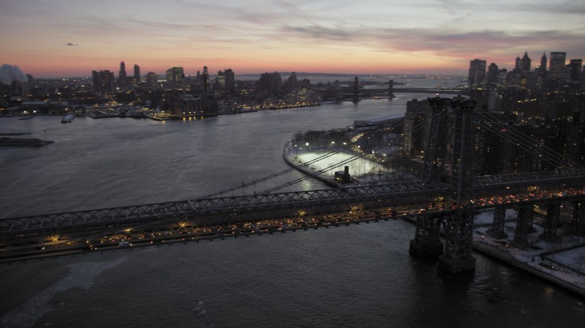 5K stock footage aerial video of Williamsburg Bridge and Lower East Side in winter, New York City, twilight Aerial Stock Footage | AX66_0360