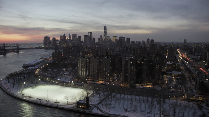 Lower East Side and Lower Manhattan skyline in winter, New York City twilight Aerial Stock Footage | AX66_0361