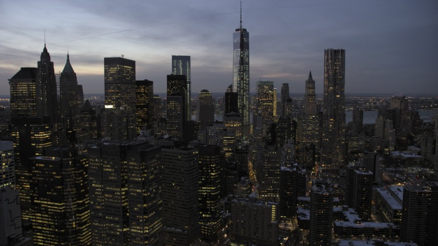 5K stock footage aerial video of Lower Manhattan skyscrapers in winter, New York City, twilight Aerial Stock Footage | AX66_0368