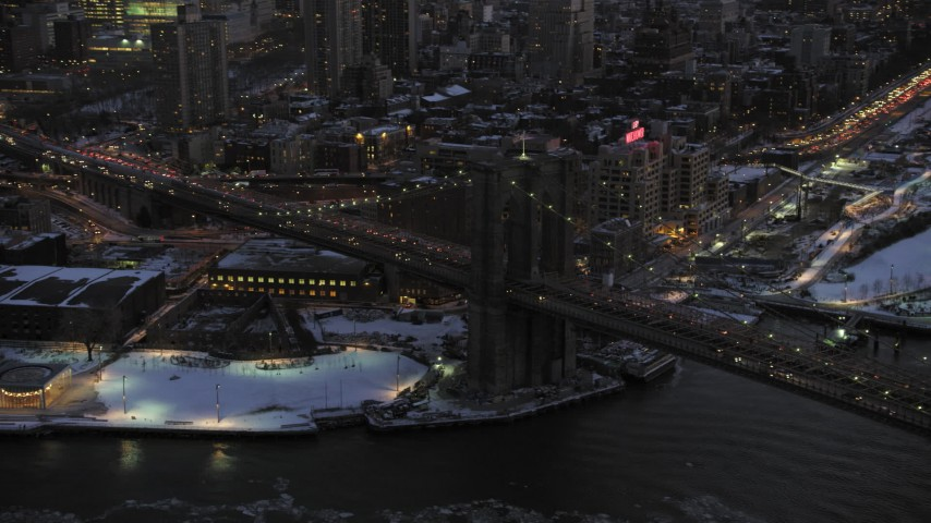 5K aerial video of orbiting Brooklyn Bridge in winter, New York City, twilight Aerial Stock Footage | AX66_0369