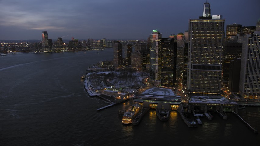 Lower Manhattan and Jersey City in winter, New York City Sunset Aerial Stock Footage | AX66_0374