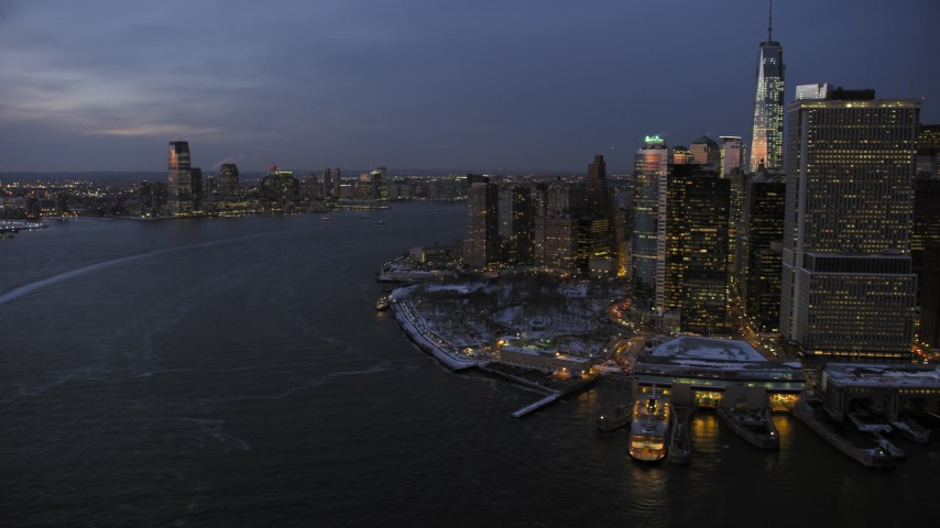 5K stock footage aerial video of Lower Manhattan and Jersey City in winter, New York City, twilight Aerial Stock Footage | AX66_0374