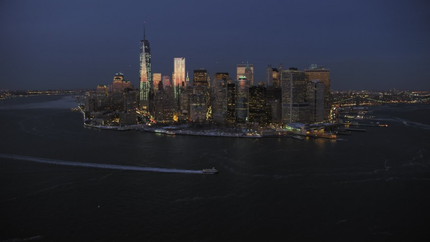 5K stock footage aerial video of Lower Manhattan skyline in winter, New York City, twilight Aerial Stock Footage | AX66_0376