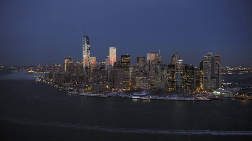 5K stock footage aerial video of the Lower Manhattan skyline and Battery Park in winter, New York City, twilight Aerial Stock Footage | AX66_0377