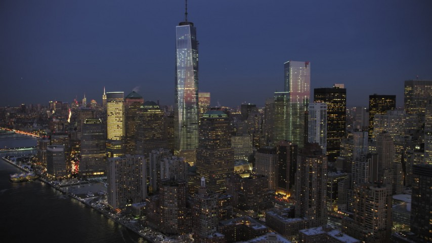 One World Trade Center and Memorial in winter, New York City twilight Aerial Stock Footage | AX66_0380