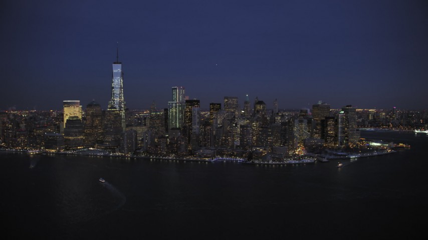5K stock footage aerial video approach the Lower Manhattan skyline in winter, New York City, twilight Aerial Stock Footage   AX66_0384