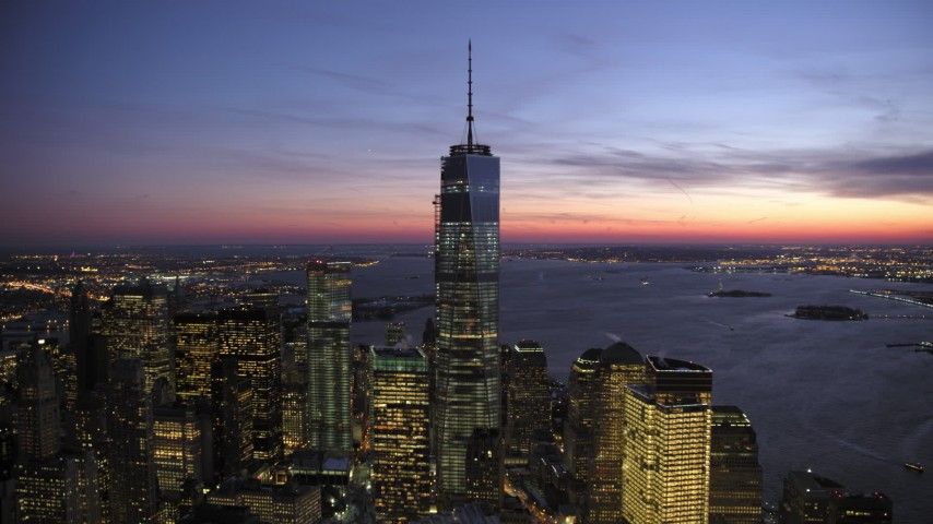 5K stock footage aerial video orbit away from the One World Trade Center in winter, New York City, twilight Aerial Stock Footage | AX66_0389