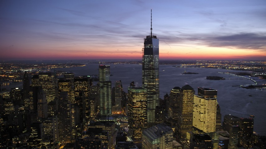Reverse One World Trade Center in winter, New York City twilight Aerial Stock Footage | AX66_0390