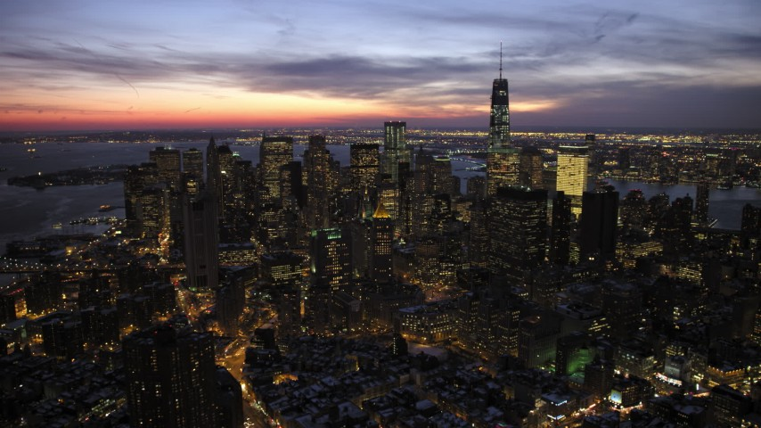 5K stock footage aerial video of reverse view of Lower Manhattan's skyscrapers in winter, New York City, twilight Aerial Stock Footage | AX66_0392