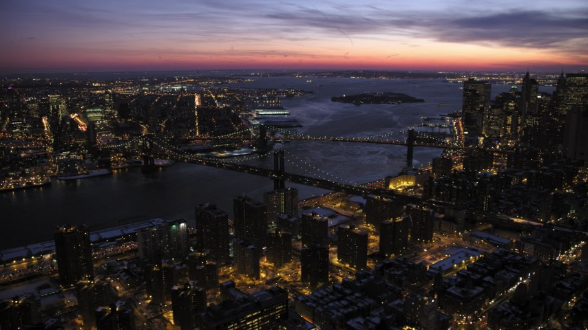 5K stock footage aerial video of Manhattan and Brooklyn Bridges in winter, New York City, twilight Aerial Stock Footage | AX66_0393