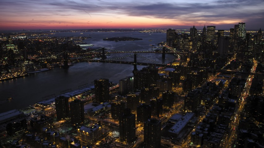5K stock footage aerial video of Manhattan and Brooklyn Bridges in winter, New York City, twilight Aerial Stock Footage | AX66_0394