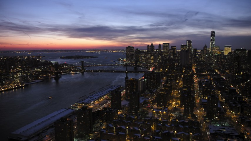 5K stock footage aerial video of Manhattan and Brooklyn Bridges, Lower East Side apartments in winter, New York City, twilight Aerial Stock Footage | AX66_0395