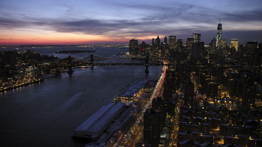5K stock footage aerial video of Manhattan and Bridge Brooklyn Bridges and Lower Manhattan Skyline in winter, New York City, twilight Aerial Stock Footage | AX66_0396