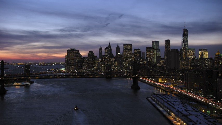5K aerial stock footage video of Manhattan Bridge and Lower Manhattan skyline, New York City, twilight Aerial Stock Footage | AX66_0397