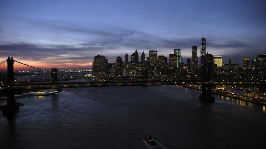 5K stock footage aerial video approach Manhattan Bridge and Lower Manhattan skyline, New York City, twilight Aerial Stock Footage | AX66_0398