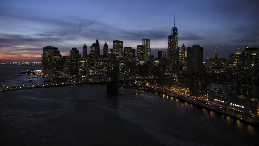 5K stock footage aerial video approach Brooklyn Bridge and Lower Manhattan skyline, New York City, twilight Aerial Stock Footage | AX66_0400