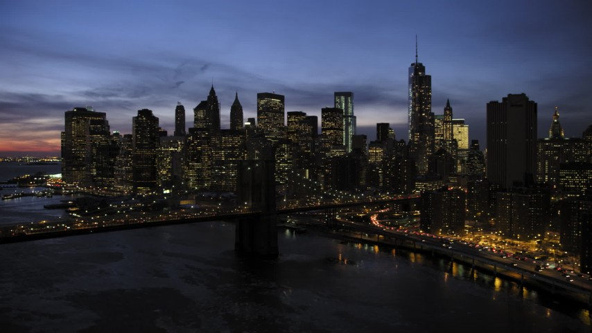 5K stock footage aerial video slowly approach Brooklyn Bridge and Lower Manhattan, New York City, twilight Aerial Stock Footage | AX66_0401