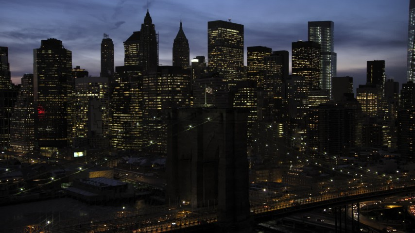 Brooklyn Bridge and Lower Manhattan skyline in winter, New York City Sunset Aerial Stock Footage | AX66_0402