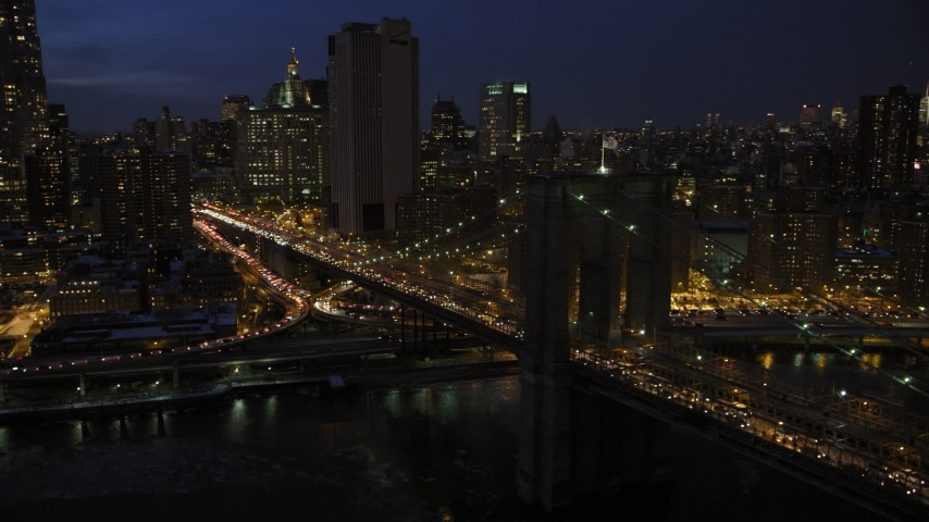 5K aerial video of the Brooklyn Bridge in winter, New York City, night Aerial Stock Footage | AX66_0405