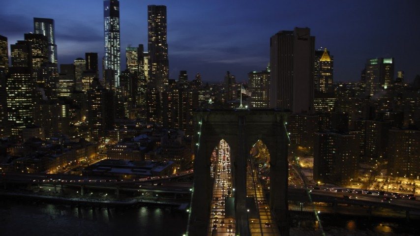 5K stock footage aerial video orbit Brooklyn Bridge, reveal Lower Manhattan skyscrapers in winter, New York City, twilight Aerial Stock Footage | AX66_0406